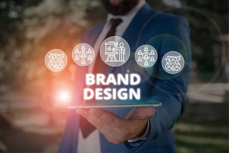Word writing text Brand Design. Business photo showcasing visual elements that make up the corporate or brand identity Male human wear formal work suit presenting presentation using smart device
