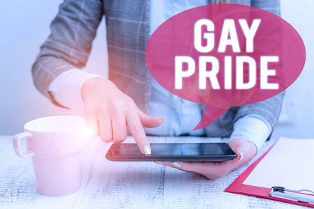 Text sign showing Gay Pride. Business photo showcasing Dignity of an idividual that belongs to either a analysis or woanalysis Business woman sitting with mobile phone and cup of coffee on the table