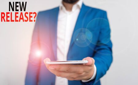 Word writing text New Release Question. Business photo showcasing asking about recent product or service newly unleashed Business concept with man holding mobile phone with touch screen