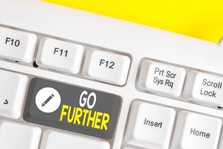 Writing note showing Go Further. Business concept for To move to a greater distance or overcome your limitations White pc keyboard with note paper above the white background