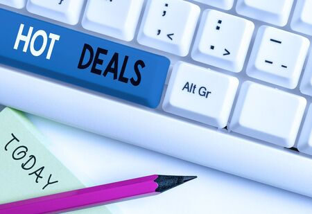 Writing note showing Hot Deals. Business concept for An agreement through which one of the paties is offered and accept White pc keyboard with note paper above the white background