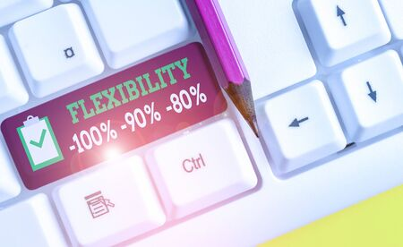 Writing note showing Flexibility 100 Percent 90 Percent 80 Percent. Business concept for How much flexible you are maleability level White pc keyboard with note paper above the white background