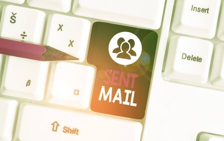 Text sign showing Sent Mail. Business photo text Event where a letter to be taken somewhere or goes to the receiver White pc keyboard with empty note paper above white background key copy space
