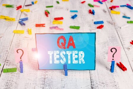 Word writing text Qa Tester. Business photo showcasing Quality assurance of an on going project before implementation Scribbled and crumbling sheet with paper clips placed on the wooden table