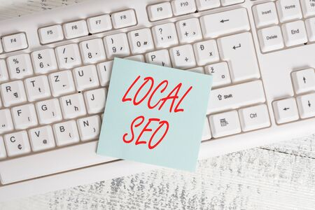 Conceptual hand writing showing Local Seo. Concept meaning This is an effective way of marketing your business online Keyboard office supplies rectangle shape paper reminder wood