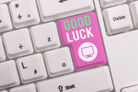 Text sign showing Good Luck. Business photo text A positive fortune or a happy outcome that a demonstrating can have White pc keyboard with empty note paper above white background key copy space