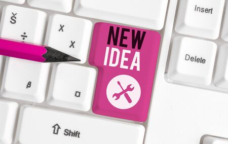 Text sign showing New Idea. Business photo showcasing A thought or conception refer to a product of mental activity White pc keyboard with empty note paper above white background key copy space 写真素材