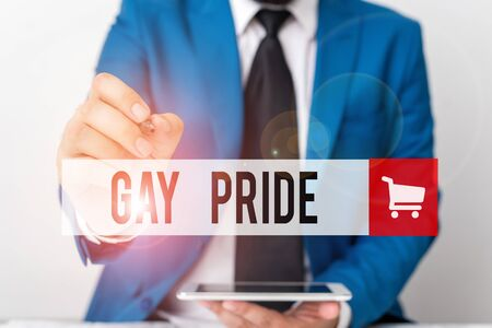 Word writing text Gay Pride. Business photo showcasing Dignity of an idividual that belongs to either a analysis or woanalysis Businessman pointing with pen in empty copy space