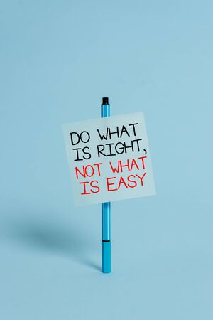 Text sign showing Do What Is Right Not What Is Easy. Business photo showcasing Make correct actions Have integrity Ballpoint blank colored sticky note peaceful cool pastel fashion background