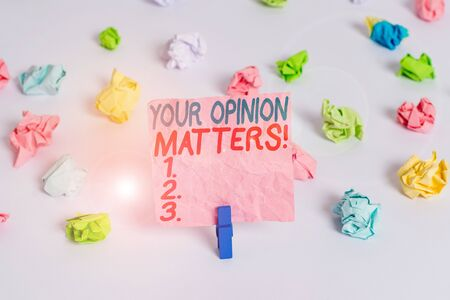 Conceptual hand writing showing Your Opinion Matters. Concept meaning show you do not agree with something that just been said Colored crumpled paper empty reminder white floor clothespin