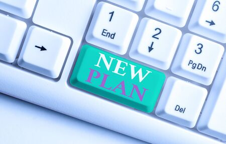 Text sign showing New Plan. Business photo showcasing Start of a detailed proposal of doing or achieving something White pc keyboard with empty note paper above white background key copy space