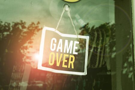 Text sign showing Game Over. Business photo text A situation in a particular sport that reach his finals or ending Empty black board with copy space for advertising. Blank dark board Imagens
