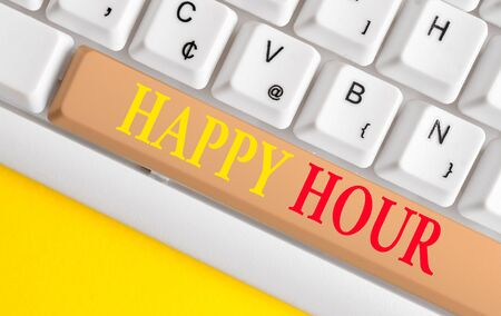 Conceptual hand writing showing Happy Hour. Concept meaning Spending time for activities that makes you relax for a while White pc keyboard with note paper above the white background