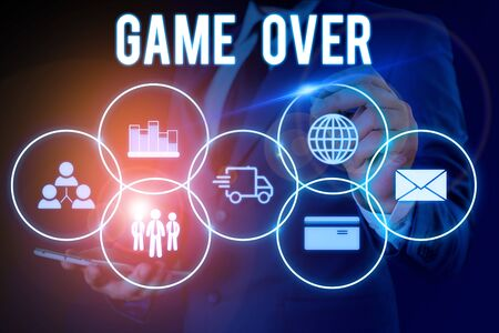 Word writing text Game Over. Business photo showcasing A situation in a particular sport that reach his finals or ending Male human wear formal work suit presenting presentation using smart device