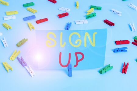 Handwriting text Sign Up. Conceptual photo use your information to register in website team college or blog Colored clothespin papers empty reminder blue floor background office pin