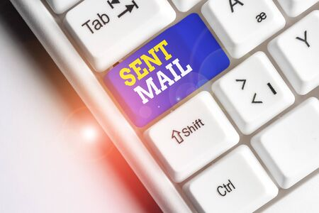 Conceptual hand writing showing Sent Mail. Concept meaning Event where a letter to be taken somewhere or goes to the receiver White pc keyboard with note paper above the white background