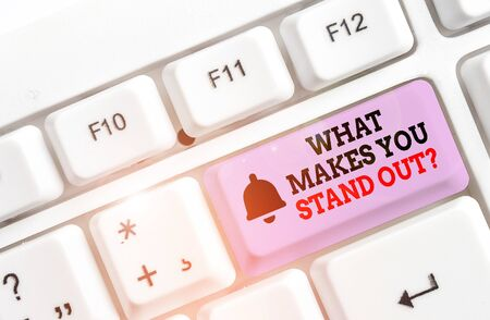 Writing note showing What Makes You Stand Out Question. Business concept for asking someone about his qualities White pc keyboard with note paper above the white background Stock Photo