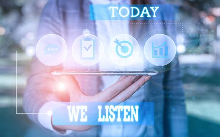 Text sign showing We Listen. Business photo showcasing Group of showing that is willing to hear anything you want to say Female human wear formal work suit presenting presentation use smart device