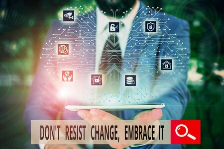 Conceptual hand writing showing Don T Resist Change Embrace It. Concept meaning Be open to changes try new things positive Male wear formal work suit presenting presentation smart device