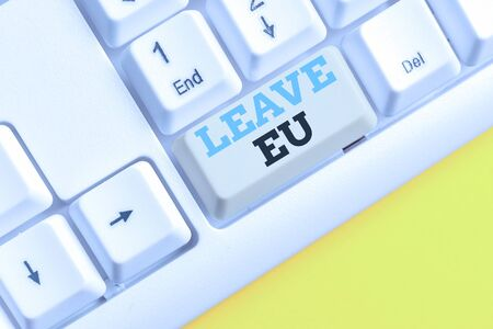 Handwriting text Leave Eu. Conceptual photo An act of a demonstrating to leave a country that belongs to Europe White pc keyboard with empty note paper above white background key copy space
