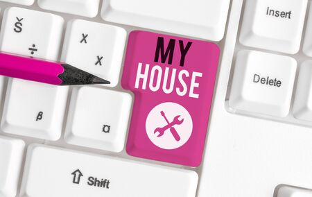 Text sign showing My House. Business photo showcasing A place or building where i live with the showing whom i loved White pc keyboard with empty note paper above white background key copy space