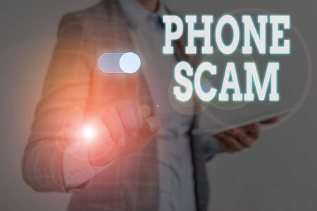 Writing note showing Phone Scam. Business concept for getting unwanted calls to promote products or service Telesales Woman wear formal work suit presenting presentation using smart device Stock Photo