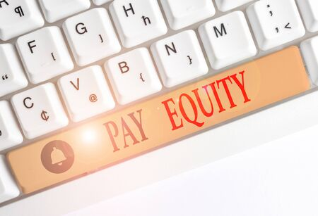 Word writing text Pay Equity. Business photo showcasing eliminating sex and race discrimination in wage systems White pc keyboard with empty note paper above white background key copy space Zdjęcie Seryjne