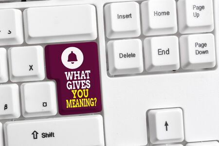 Writing note showing What Gives You Meaning Question. Business concept for your purpose or intentions in life White pc keyboard with note paper above the white background Archivio Fotografico