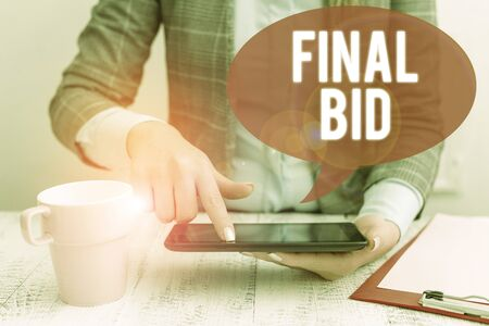Text sign showing Final Bid. Business photo showcasing The decided cost of an item which is usualy very expensive Business woman sitting with mobile phone and cup of coffee on the table