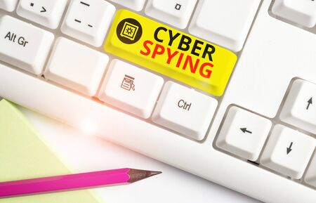 Text sign showing Cyber Spying. Business photo text form of cyber attack that steals classified or sensitive data White pc keyboard with empty note paper above white background key copy space Stock fotó