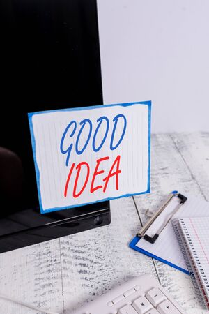 Writing note showing Good Idea. Business concept for State of huanalysis brain to bring great intelegence towards something Note paper taped to black computer screen near keyboard and stationary 写真素材