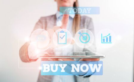 Text sign showing Buy Now. Business photo text asking someone to purchase your product Provide good Discount Female human wear formal work suit presenting presentation use smart device Foto de archivo - 131387855