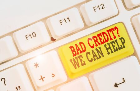 Conceptual hand writing showing Bad Credit Question We Can Help. Concept meaning Borrower with high risk Debts Financial White pc keyboard with note paper above the white background