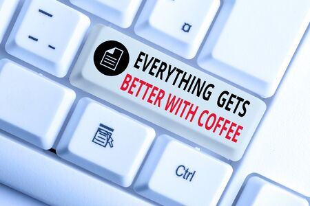 Handwriting text writing Everything Gets Better With Coffee. Conceptual photo Have a hot drink when having problems White pc keyboard with empty note paper above white background key copy space