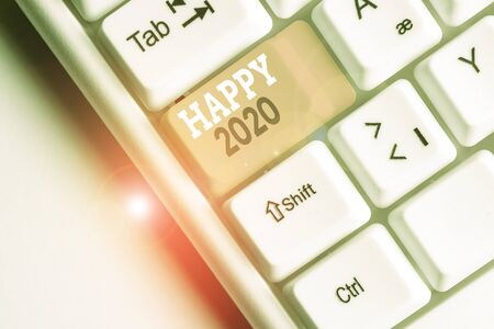 Writing note showing Happy 2020. Business concept for time or day at which a new calendar year begin from now White pc keyboard with note paper above the white background