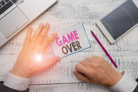 Conceptual hand writing showing Game Over. Concept meaning A situation in a particular sport that reach his finals or ending Stock Photo