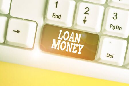 Conceptual hand writing showing Loan Money. Concept meaning Something lent or furnished on condition being returned White pc keyboard with note paper above the white background