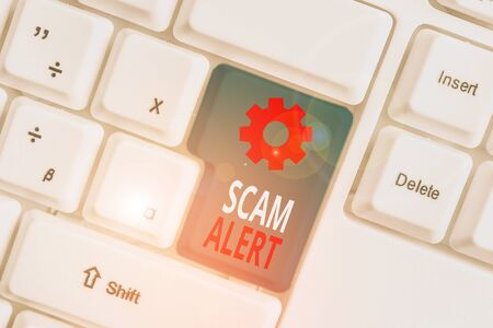 Word writing text Scam Alert. Business photo showcasing warning someone about scheme or fraud notice any unusual White pc keyboard with empty note paper above white background key copy space