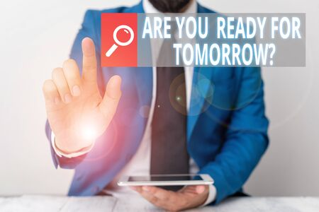 Writing note showing Are You Ready For Tomorrow Question. Business concept for Preparation to the future Motivation Businessman with pointing finger in front of him