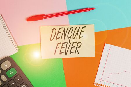 Handwriting text Dengue Fever. Conceptual photo infectious disease caused by a flavivirus or aedes mosquitoes Office appliance colorful square desk study supplies empty paper sticker Imagens