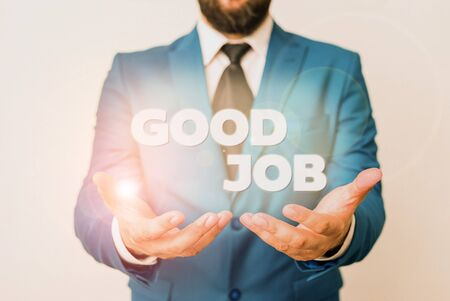 Text sign showing Good Job. Business photo showcasing encourage someone for his effort hard work winning or success Man with opened hands in fron of the table. Mobile phone and notes on the table