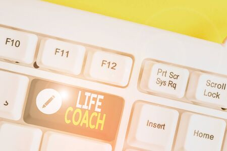 Writing note showing Life Coach. Business concept for A demonstrating who advices clients how to solve their problems or goals White pc keyboard with note paper above the white background