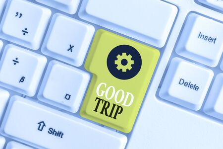 Conceptual hand writing showing Good Trip. Concept meaning A journey or voyage,run by boat,train,bus,or any kind of vehicle White pc keyboard with note paper above the white background
