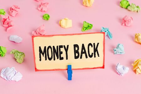Conceptual hand writing showing Money Back. Concept meaning get what you paid in return for defect or problem in product Colored crumpled papers empty reminder pink floor clothespin
