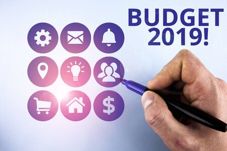 Conceptual hand writing showing Budget 2019. Concept meaning estimate of income and expenditure for current year Male designing layout presentation concept for business promotion Zdjęcie Seryjne
