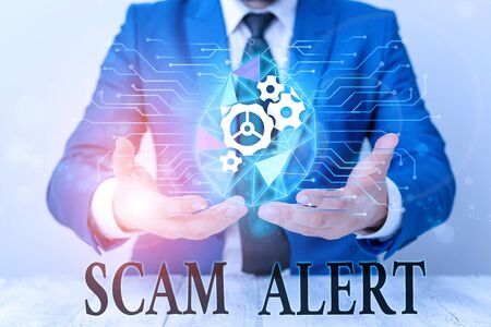 Writing note showing Scam Alert. Business concept for warning someone about scheme or fraud notice any unusual Male human wear formal suit presenting using smart device Stock fotó