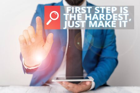 Writing note showing First Step Is The Hardest Just Make It. Business concept for dont give up on final route Businessman with pointing finger in front of him Stockfoto