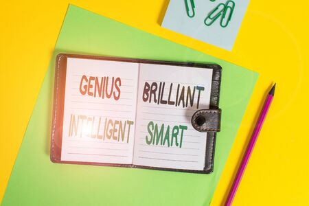 Conceptual hand writing showing Genius Brilliant Intelligent Smart. Concept meaning Clever Bright Knowledge Intelligence Locked diary striped sheets clips notepad colored background