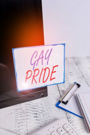 Writing note showing Gay Pride. Business concept for Dignity of an idividual that belongs to either a analysis or woanalysis Note paper taped to black computer screen near keyboard and stationary