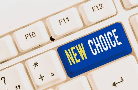 Text sign showing New Choice. Business photo showcasing having lot of options and adding another one to choose between White pc keyboard with empty note paper above white background key copy space
